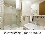 interior of a hotel bathroom... | Shutterstock . vector #1044775885