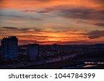 urban sunset sky | Shutterstock . vector #1044784399