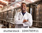 young black male wine factory... | Shutterstock . vector #1044785911