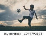 young little boy playing in the ... | Shutterstock . vector #1044793975
