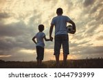father and young little boy... | Shutterstock . vector #1044793999