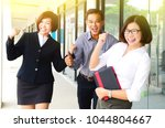 excited middle aged asian... | Shutterstock . vector #1044804667