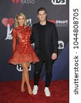 chris zylka and paris hilton at ... | Shutterstock . vector #1044808705