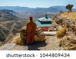 Small photo of Priest looking over scarp at monastery Debre Damo, near Adigrat in Tigray Region, Ethiopia.