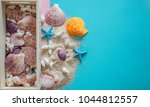 top view colorful  seashells... | Shutterstock . vector #1044812557