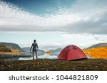 angler stands on the coast of a ... | Shutterstock . vector #1044821809