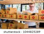 happy people working with... | Shutterstock . vector #1044825289