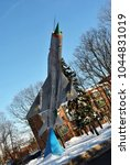 Small photo of February 2018: Monument of rocketing Su-24 plane in winter park near air force academy, Kharkiv, Ukraine, vertical view from bottom