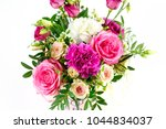 composition of flowers in a... | Shutterstock . vector #1044834037