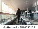 unrecognizable woman walking... | Shutterstock . vector #1044853135