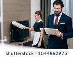 hotel administrator using... | Shutterstock . vector #1044862975