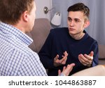 sad guy with his father are... | Shutterstock . vector #1044863887