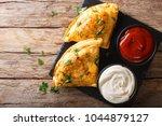 italian food  pizza calzone... | Shutterstock . vector #1044879127