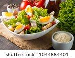 fresh caesar salad with... | Shutterstock . vector #1044884401