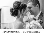 the bride and groom standing on ...   Shutterstock . vector #1044888067