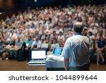 speaker giving a talk on... | Shutterstock . vector #1044899644
