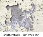 closeup of peeling painted wall | Shutterstock . vector #1044921454