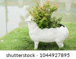 Flowerpot Sheep In Garden
