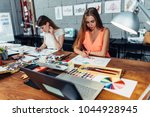 designers workspace. two female ...   Shutterstock . vector #1044928945