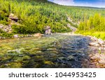 mountain forest river landscape | Shutterstock . vector #1044953425