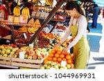 young attractive fruit market... | Shutterstock . vector #1044969931