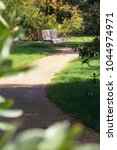 footpath with bench | Shutterstock . vector #1044974971