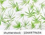 green leaves on white background | Shutterstock . vector #1044979654