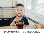 beautiful baby sitting in the... | Shutterstock . vector #1045000039