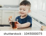 beautiful baby sitting in the... | Shutterstock . vector #1045000075