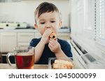 beautiful baby sitting in the... | Shutterstock . vector #1045000099