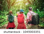 group of hikers hiking trail to ...   Shutterstock . vector #1045003351