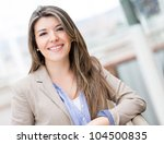 Portrait of a casual young woman smiling - stock photo