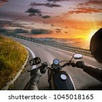 pov of motorbiker holding... | Shutterstock . vector #1045018165