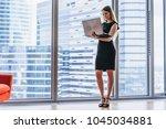 businesswoman holding laptop... | Shutterstock . vector #1045034881
