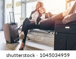 two tired female tourists... | Shutterstock . vector #1045034959