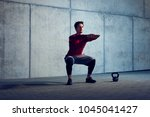 athletic man doing squat... | Shutterstock . vector #1045041427