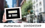 Small photo of Digital composite of Hand holding tablet with Rate button and star ratings review icons in city
