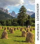 dolomite mountains and hay... | Shutterstock . vector #1045046509