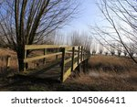 a wooden bridge over a creek... | Shutterstock . vector #1045066411