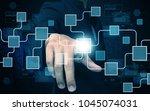 businessman press virtual screen | Shutterstock . vector #1045074031