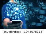businessman holding social media | Shutterstock . vector #1045078315