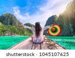 traveler woman in summer dress... | Shutterstock . vector #1045107625