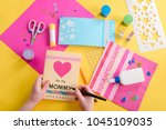 girl writing on greeting card.... | Shutterstock . vector #1045109035