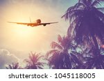 airplane flying over tropical... | Shutterstock . vector #1045118005