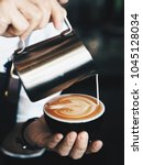 close up barista hands pouring... | Shutterstock . vector #1045128034