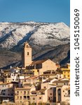 Small photo of Scenic Costa Blanca hilltop town on a sunny winter day after recent snowfall