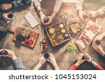 group of people having meal... | Shutterstock . vector #1045153024