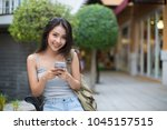asia woman using a smart phone... | Shutterstock . vector #1045157515