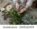the hands of florist against... | Shutterstock . vector #1045162459