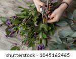 the hands of florist against... | Shutterstock . vector #1045162465
